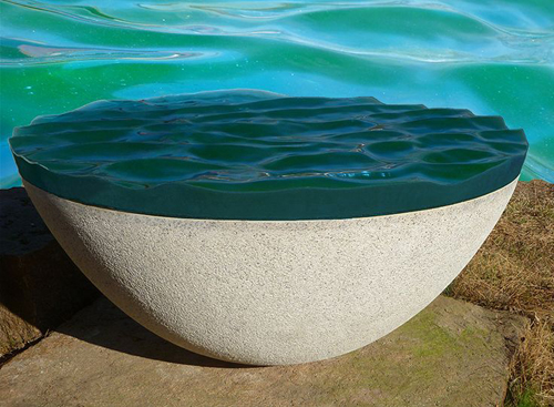 The Sea Between Us by Alena Matejka. Cast glass and granite.